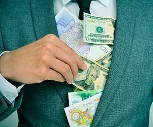 Man in suit filled with money